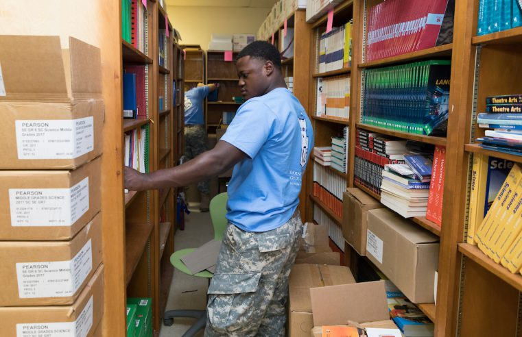 Cadet puts books away