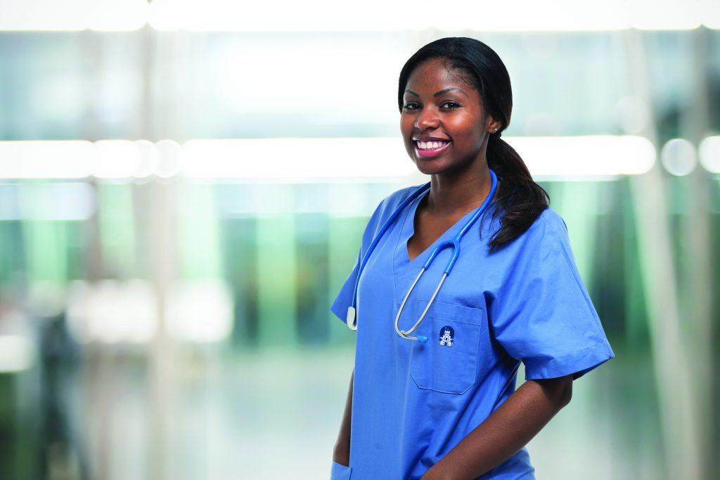 nurse smiling environmental with barracks icon