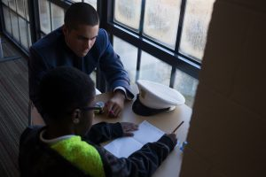 Cadet Helping Student