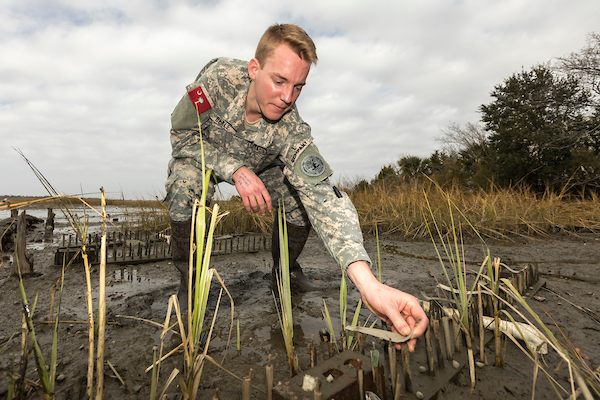 Cadet John Dekle doing an Eco Marsh Study