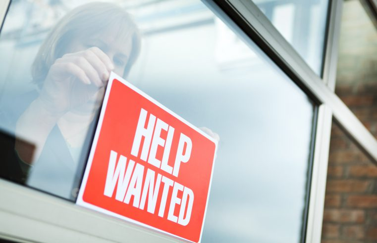 business using help wanted sign to fill job openings in the Southeast