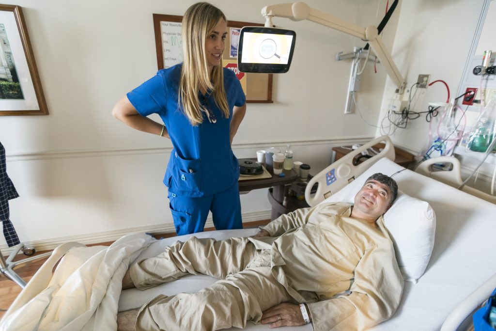 Citadel nursing student Emily Banks visits with VA patient Jose Atkinson