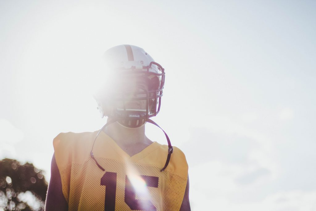 college football player attending a team practice