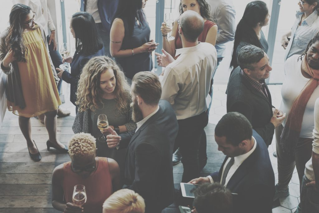 An overhead view of a networking event for young businesspeople