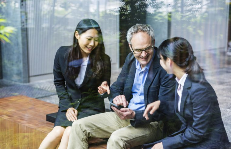 businessman working with Japanese business women on an important project