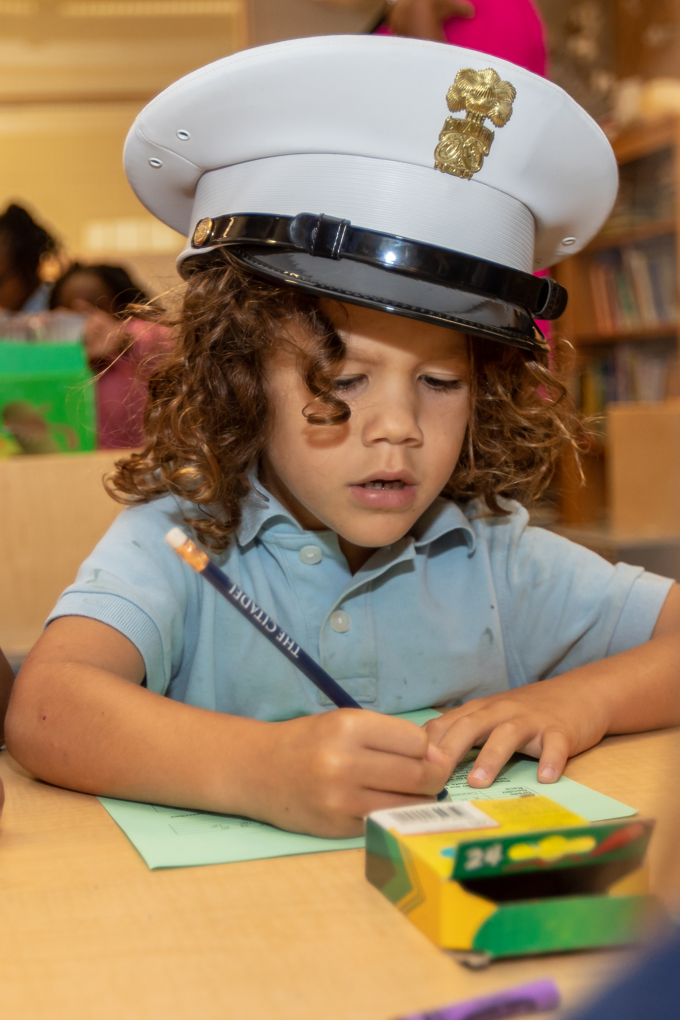 James Simons elementary student enjoys pretending to be a cadet while making a card for her hero