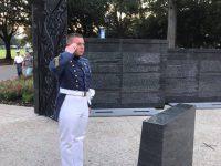 Cadet Caleb Carter on Ring Day at The Citadel War Memorial saluting alumni killed in action