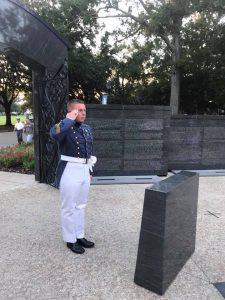 Cadet Caleb Carter on Ring Day at The Citadel War Memorial saluting alumni killed in action