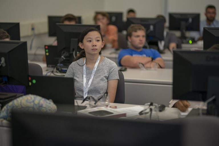 A student sits in a classroom during the GenCyber Summer Program