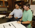 Civil engineering undergrad researcher Emmet Smith (left) with Professor Simon Ghanat
