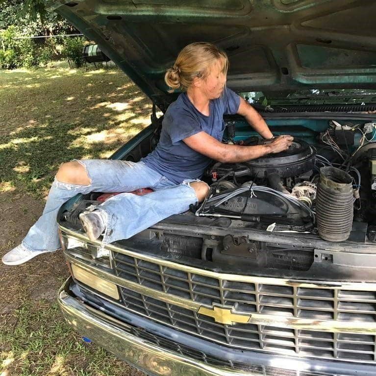 Cadet Col. Sarah Zorn, working on her truck as a teenager.