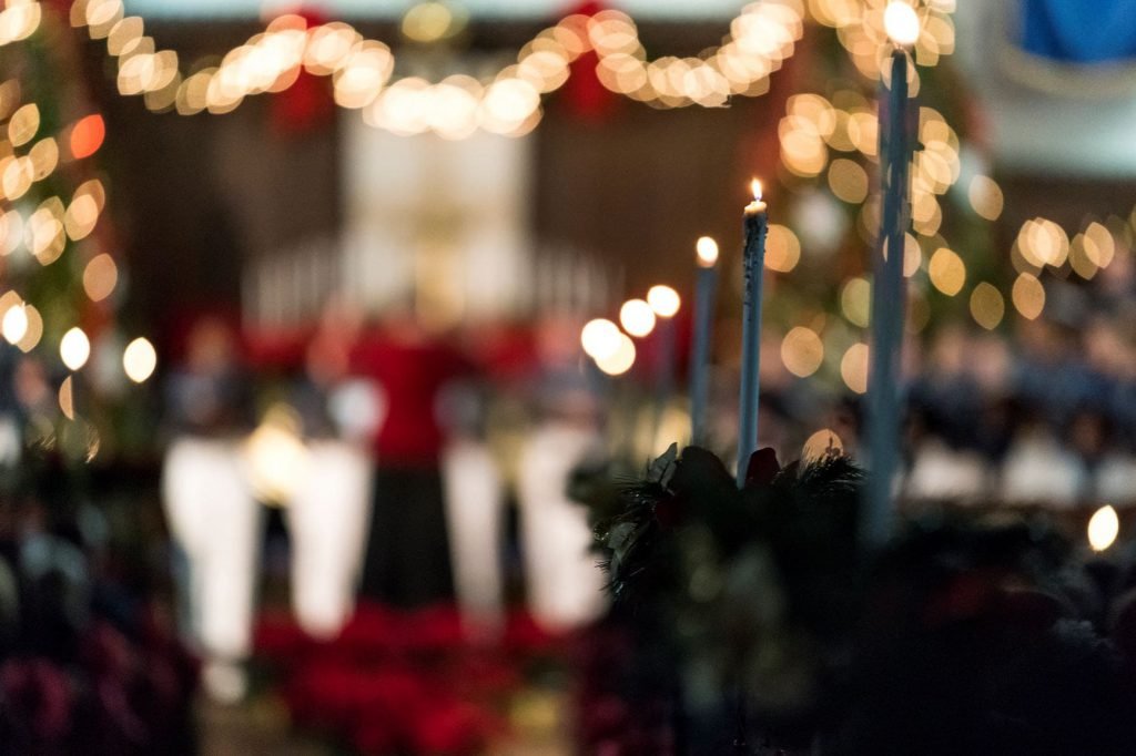 Candles line the aisle at The Citadel Christmas Candlelight services