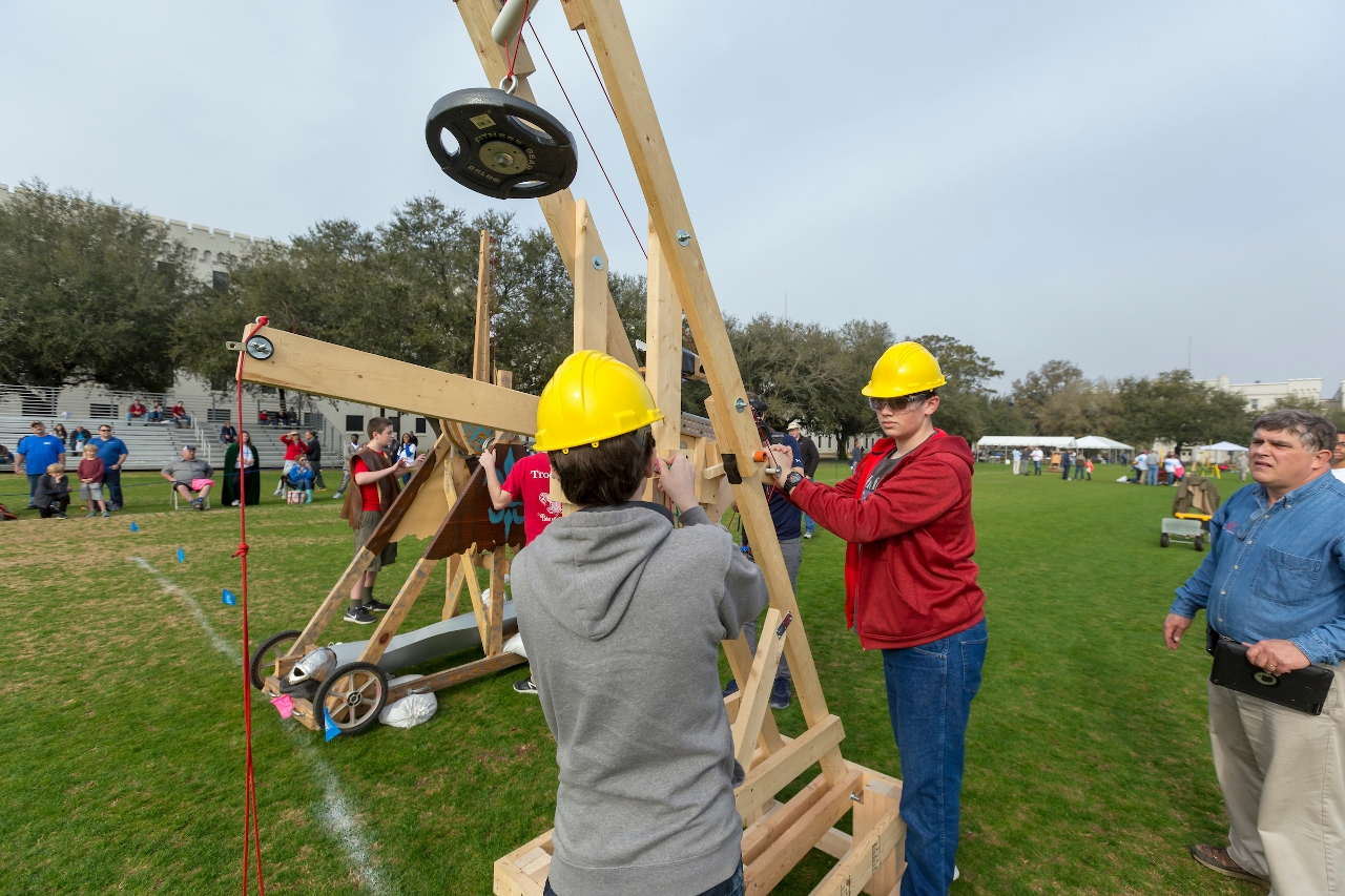 Jamison Mahoney, 17 in grey, and Byron DeJesus, 17, both of Chapin, SC., and the Center for Advanced Field Studies, prepare their trebuchet for competition at Storm the Citadel 2018