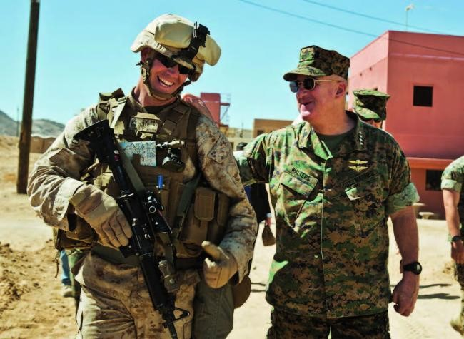 Gen Walters greets a Marine undergoing predeployment training at Marine Corps Air-Ground Combat Center, Twentynine Palms, Calif., May 18, 2017. (photo courtesy of Cpl Hailey D. Clay, USMC)