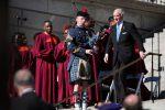 Citadel Cadet Richard Johnson playing bagpipes at inauguration as Gov. McMaster descends stairs