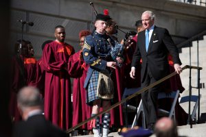 Citadel Cadet Richard Johnson playing bagpipes at inauguration as Gov. McMaster descends stairs