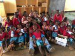 Citadel Regimental Executive Officer, David Days with school children in Kigali Rwanda