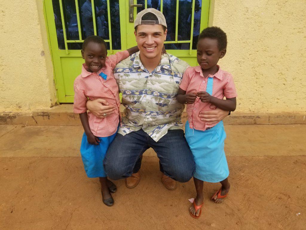 Citadel Cadet Elijah Melendez with school children he worked with in Rwanda