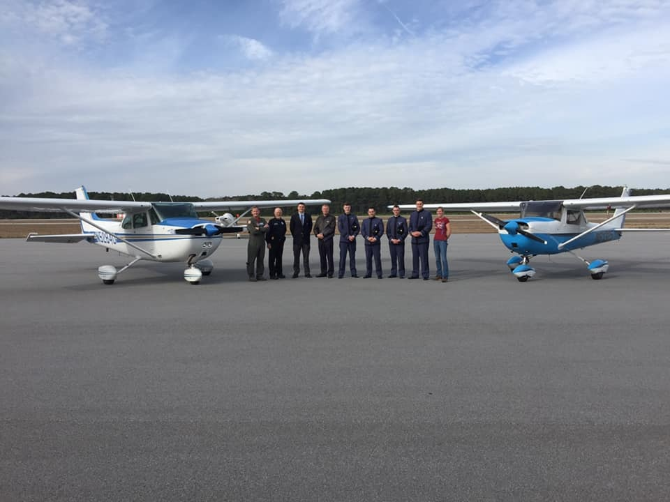 LCAA staff with planes and Citadel cadets