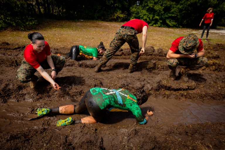 Crawling through mud during Bulldog Challenge 2018