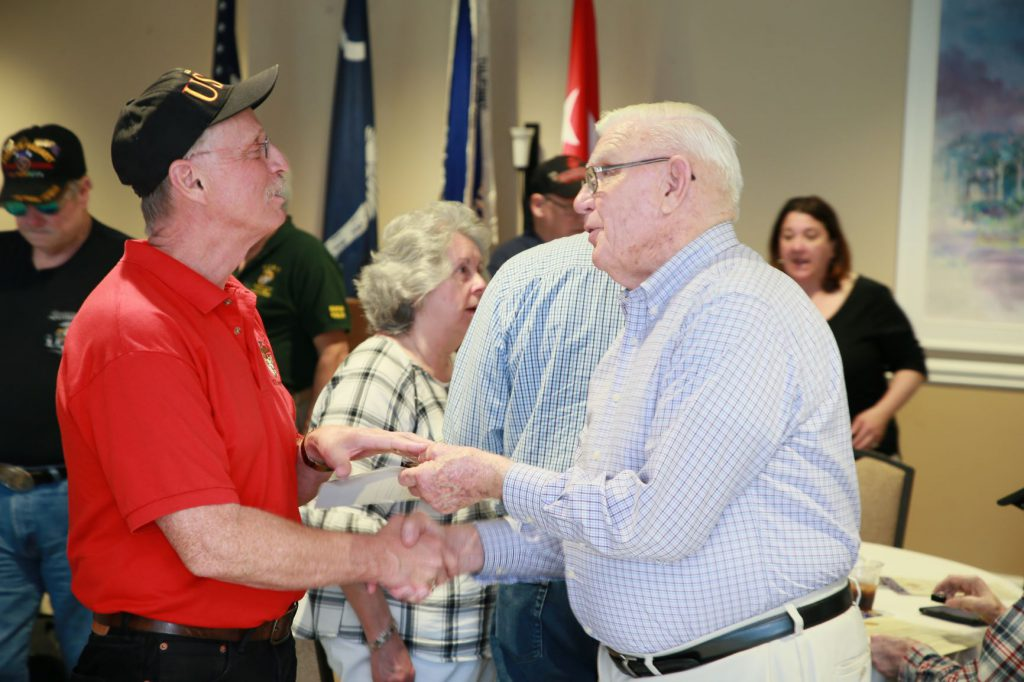 Lt. Gen. Ron Christmas handing out commemorative pins