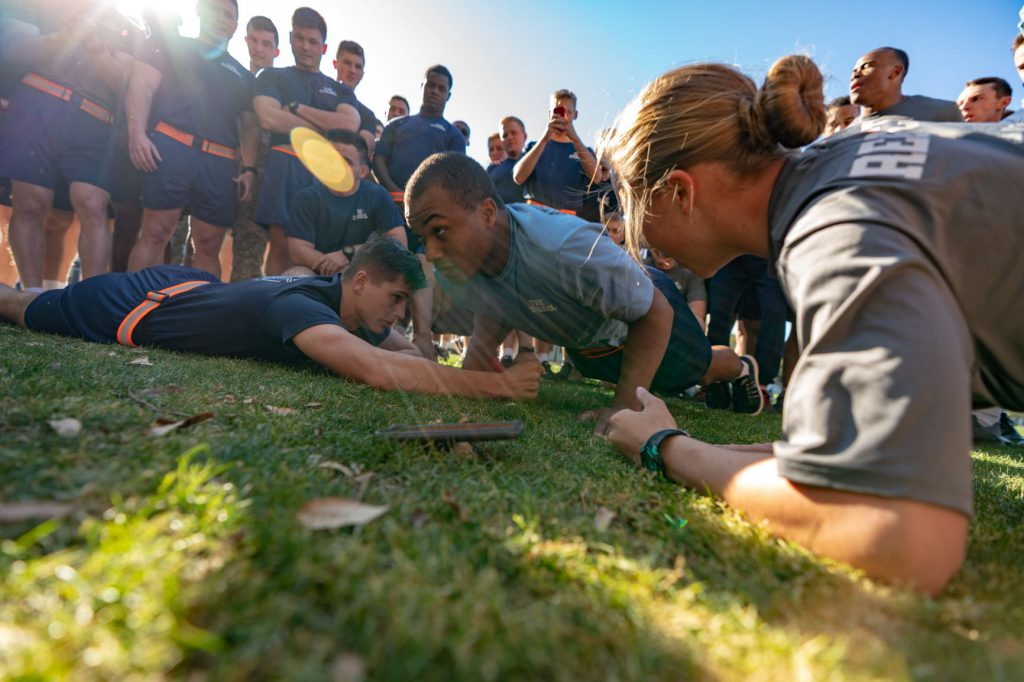Athletic Officers compete in push-up tiebreaker