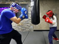 Rico Gabriel and Mary Anne Koller boxing