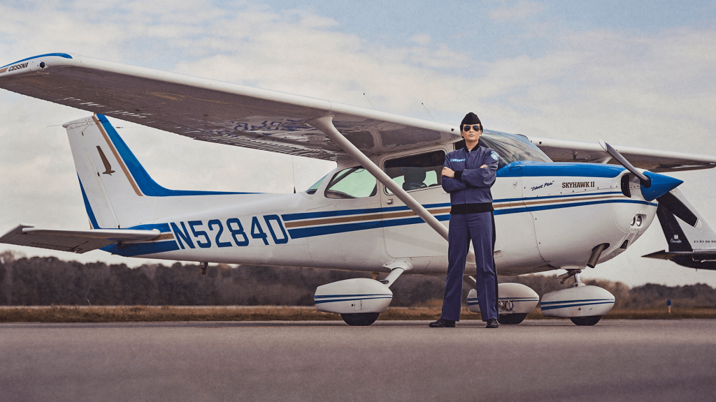 Cadet Jenna Beare stands in front of a Cessna 172 Skyhawk at the Lowcountry Aviation Center