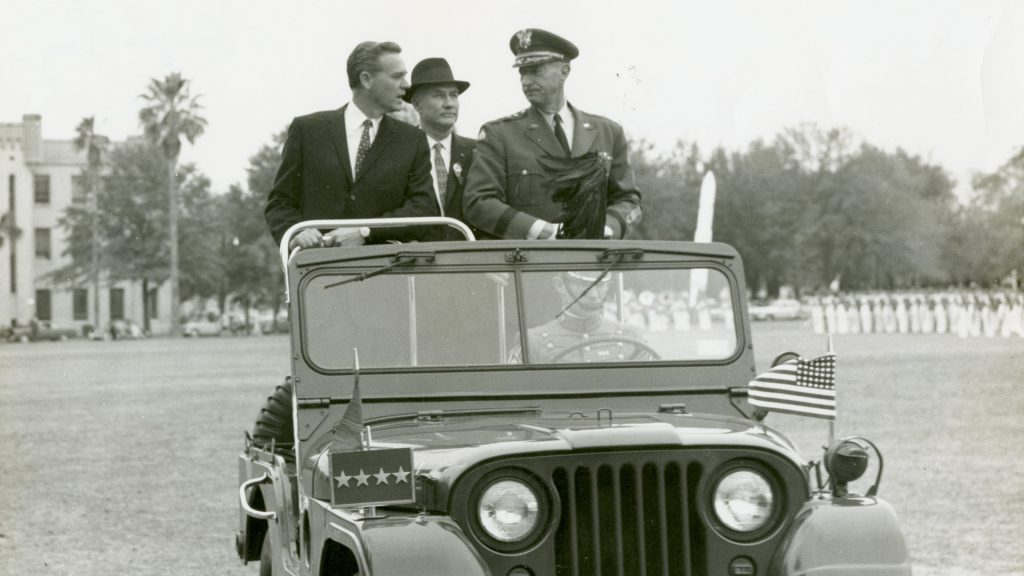 Fritz Hollings (left) with Citadel president Gen. Mark Clark (right) and Sen. Strom Thurmond, in jeep review of South Carolina Corps of Cadets military parade
