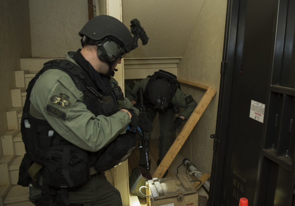 "Members of the Charleston County S.W.A.T. team clear a room in a ""shoot house"" during a joint training exercise"