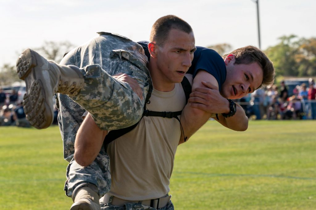 Cadet William Metts Jr. caring another cadet during the Gauntlet on Recognition Day 2019