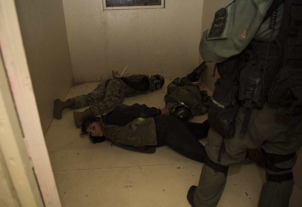 Simulated hostages are detained during a joint training exercise