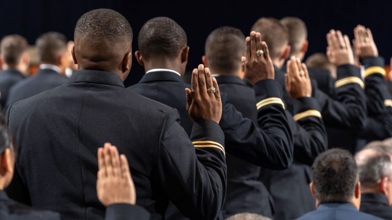 Army commissions saying oath during ceremony