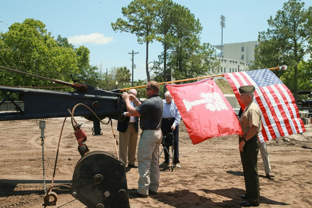 Gen. Glenn Walters and THS raising flags at construction site