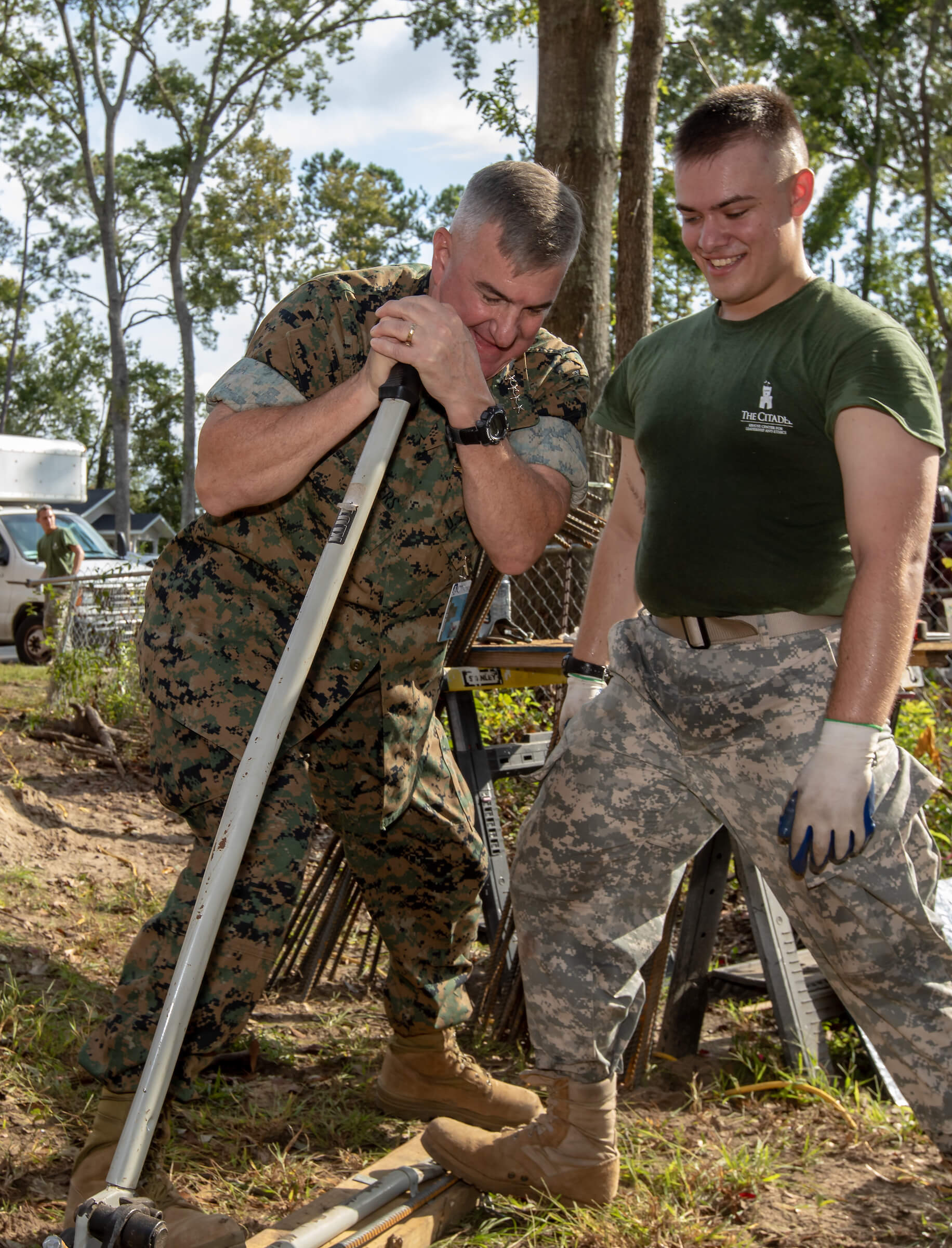 General Glenn Walters, president of The Citadel, helps a cadet bend a piece of rebar on Leadership Day 2018.