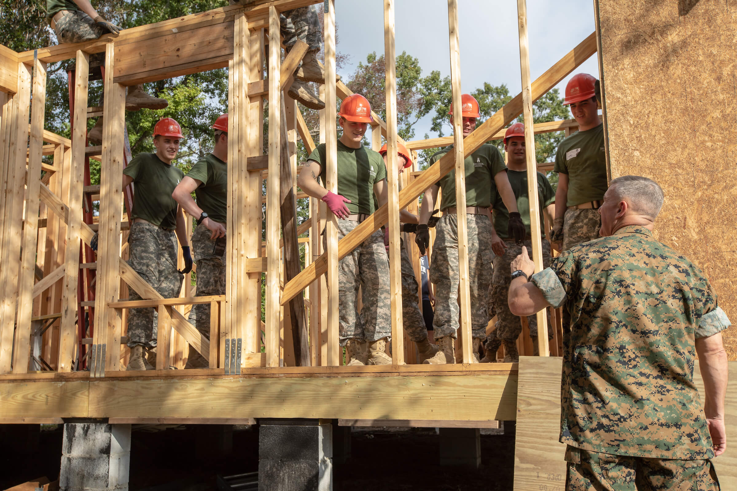 General Glenn Walters, president of The Citadel, speaks with cadets on the job site at Sea Island Habitat for Humanity on Leadership Day 2018.