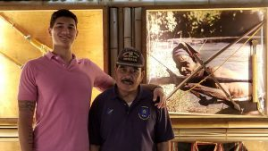 Citadel graduate Alex Pang-Riddle and his grandfather, K'Sao Krajan, aboard the USS Yorktown