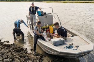 Citadel researcher Dr. John Weinstein with cadets and students collecting samples of oysters for microplastic pollution research