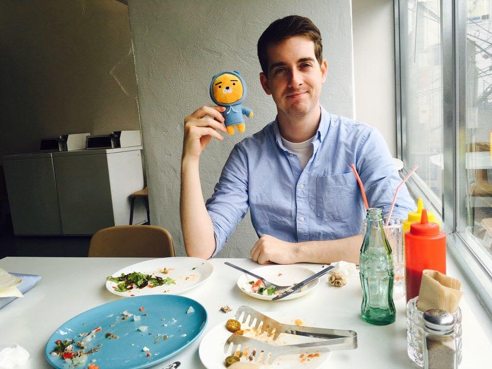 Jonathan French with Korean plush toy