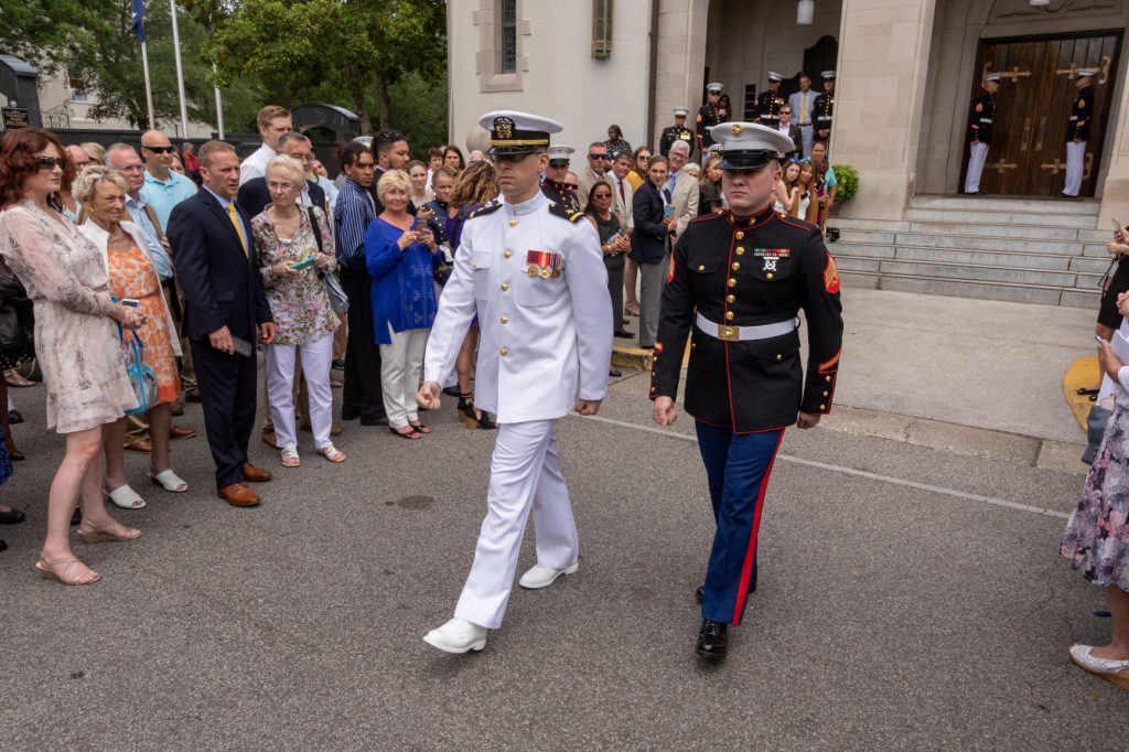 Marine and navy walking together commissioning ceremony