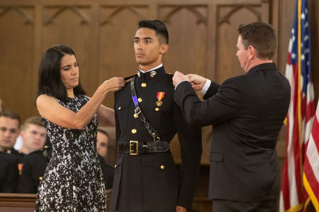 Marine with pins commissioning ceremony
