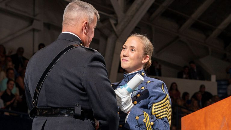 Sarah Zorn with Gen. Walters, president of The Citadel, during commencement 2019