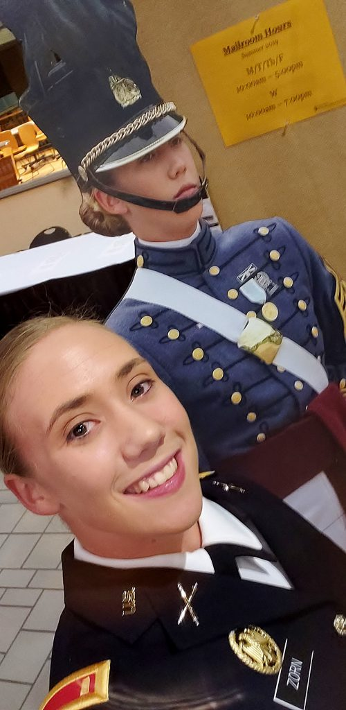 2nd Lt. Sarah Zorn with cardboard cutout of herself when Regimental Commander