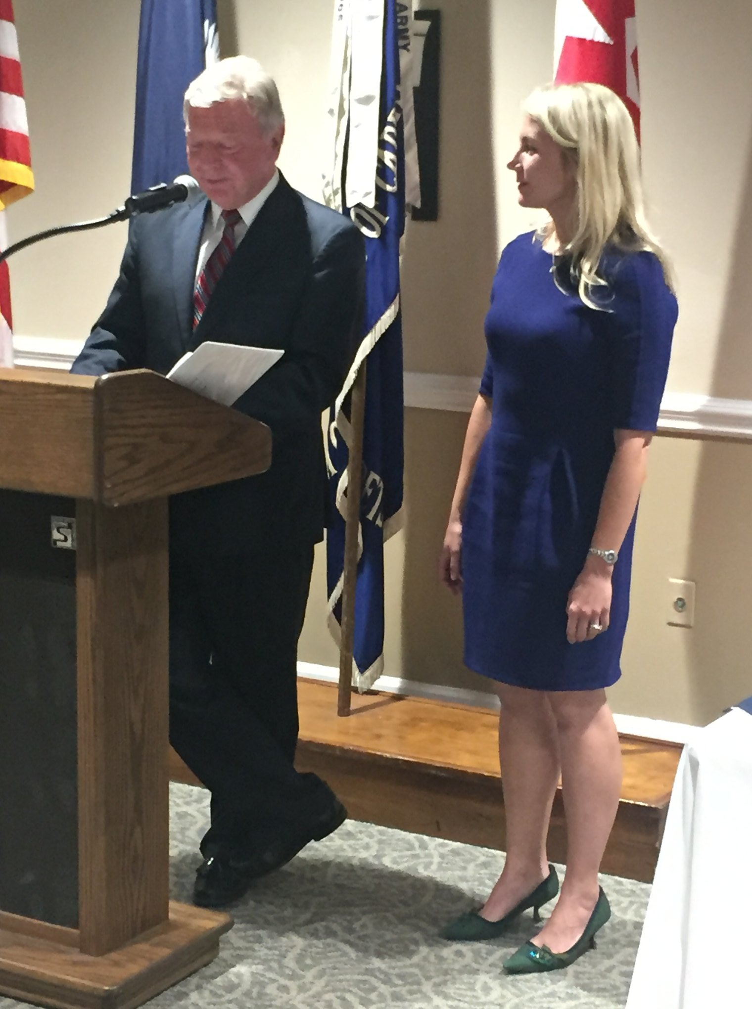Dr. Mark Bebensee congratulating a newly promote professor, Lauren Rule Maxell at banquet in 2019