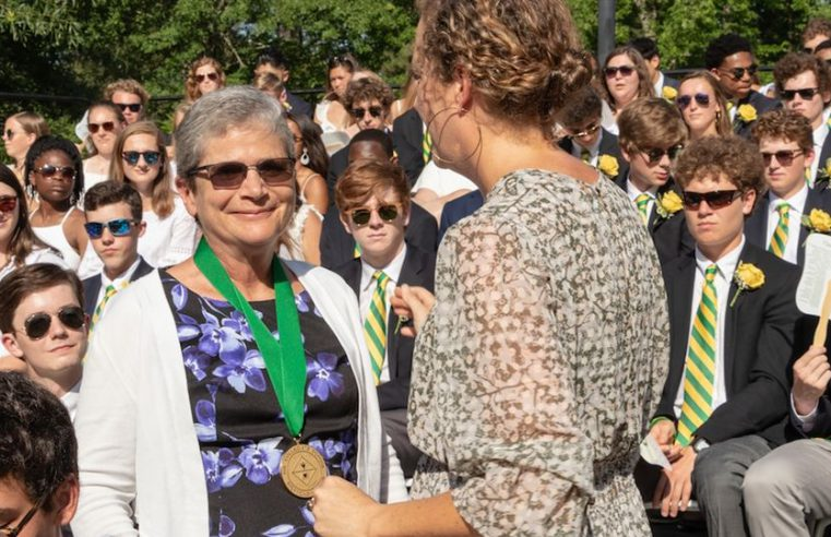 Dr. Conway Fleming Saylor '73 received the Distinguished Alumni Award at Collegiate's Commencement May 24. Neely Markel, Alumni Association president, bestowed the honor.