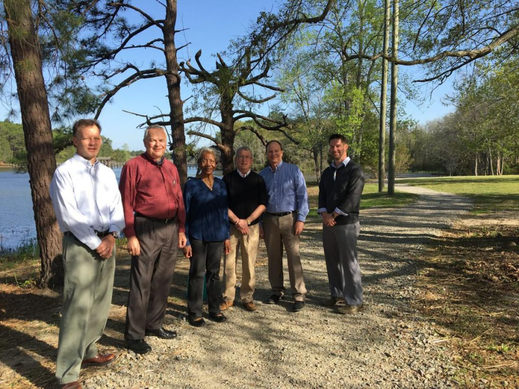 From left: Aberdeen Town Manager Paul Sabiston, Commissioner Ken Byrd, Commissioner Wilma Laney, Mayor Robbie Farrell, Commissioner Joe Dannelley, and Parks and Recreation Director Adam Crocker earlier this year for the ribbon cutting of the renovated trail around the lake.