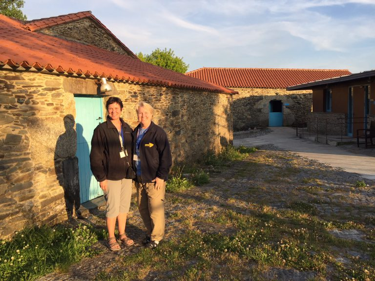 Prof. Alison Smith (left) and a co-volunteer from Indiana University, Prof. Lisa Calvin, working in Spain with the organization American Pilgrims on the Camino