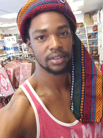 Cam Jackson tries on a turban in Turkey.