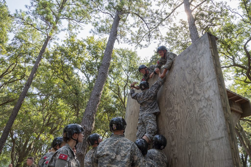The Citadel Cadre, Parris Island, teamwork to move up and over obstacle