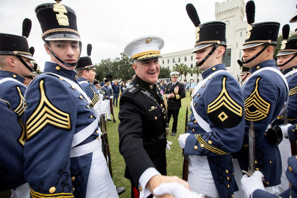 Gen. Glenn Walters shaking cadet's hand during Homecoming 2018